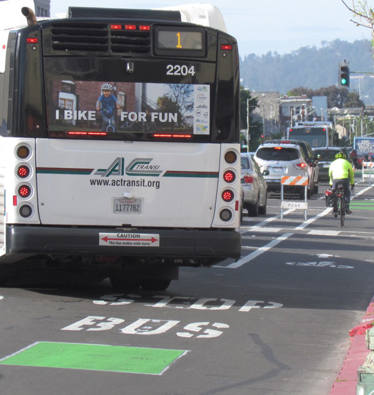 Buses still pull up to the curb to pick up and drop off passengers. Photo: Melanie Curry/Streetsblog