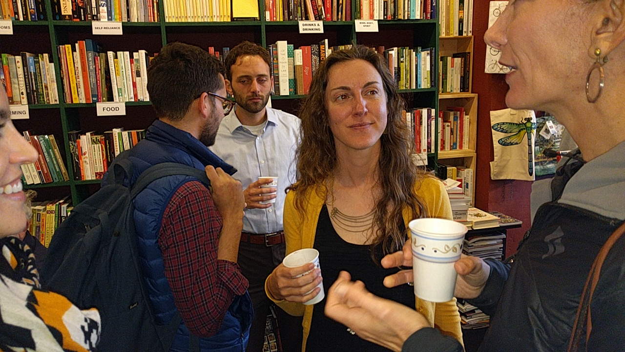 Planning rock star Nicole Foletta (in yellow and black) talks with her fans at the Green Arcade launch. Photo: Streetsblog
