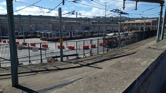 Muni's light rail facility takes up valuable real estate directly adjacent to the station. Photo: Streetsblog.