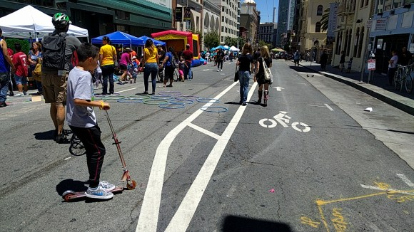 Block parties and other open streets events can bring long-term neighborhood change. So make them cheap to set up! Photo: Streetsblog.