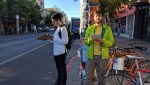 Justin Balenzvela (white) and Adam Long count bike lane violations on Valencia. Photo: Streetsblog.