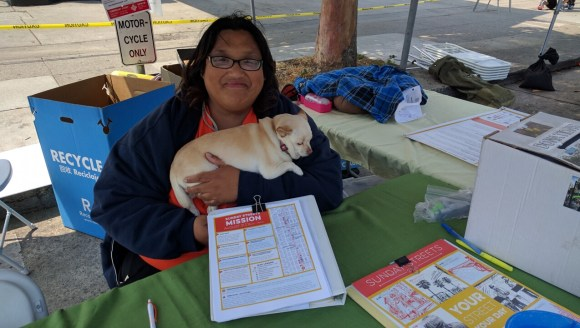 Rigel Apolinar and her dog Teyla, out volunteering for Sunday Streets in the Mission. Photo: Streetsblog.
