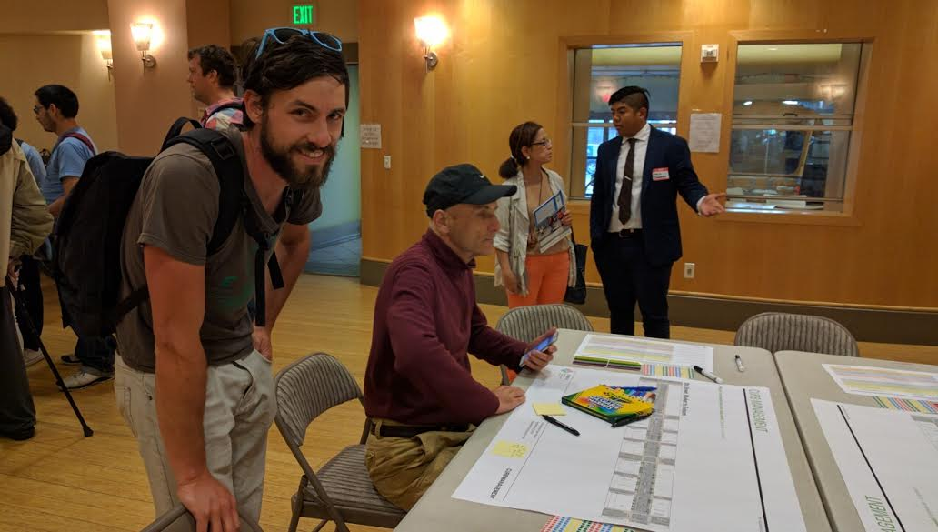 Bicycle advocate and sometimes Streetsblog contributor Adam Long at the curbside access table at SFMTA's SoMa open house. Photo: Streetsblog.