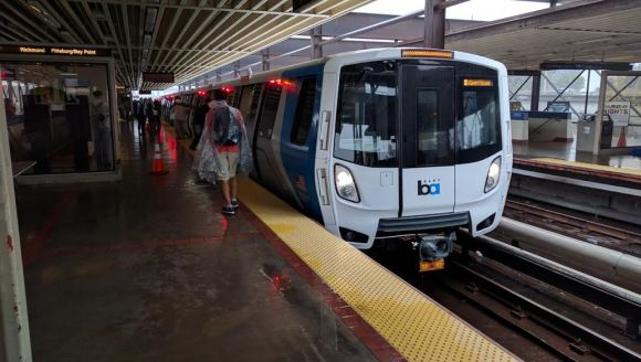 Rain didn't stop hundreds of BART customers from coming to MacArthur Station to see the new train car. Photo: Streetsblog