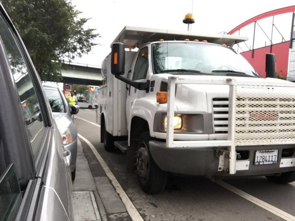 Streetsblog readers have probably seen this shot of an SFMTA truck blocking the bike lane on Folsom while it removes SFMTrA's unofficial posts. Photo: SFMTrA