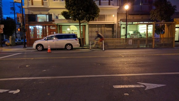 A lone, pre-dawn cyclist enjoying the safety additions on Valencia. Photo: Streetsblog