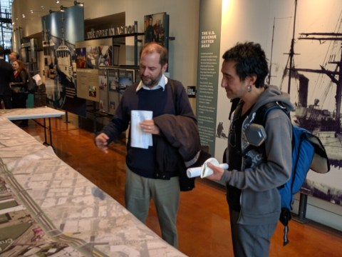 Jason Cohem and Marc Fong study the map tables at the open house. Photo: Streetsblog