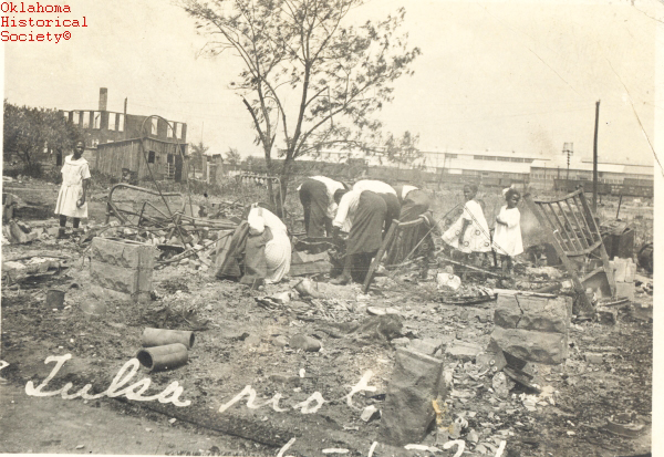 ' ' from the web at 'https://i0.wp.com/sfbayview.com/wp-content/uploads/2011/02/Tulsa-Race-Riot-Black-Wall-Street-survivors-search-ruins-060121.jpg'