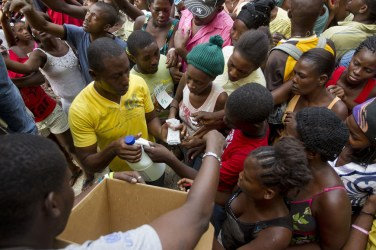 Haitians in IDP camp Port au Prince get bleach, water purification tablets to prevent cholera 121112 by Logan Abassi, UN