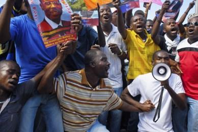 Haitians protest Aristide arrest outside courthouse Port au Prince 010913 by Swoan Parker, Reuters
