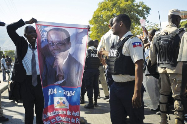 Lavalas Haitians demand Aristide court postponement at courthouse 010313 by Swoan Parker, Reuters