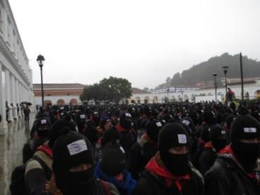 Zapatistas march in San Cristobal, Chiapas, in rain 122112 by EZLN News