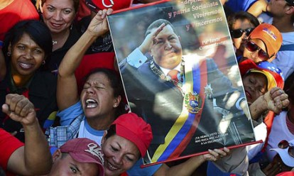 Supporters of the late president Hugo Chavez are seen outside of his funeral in Caracas
