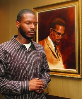 Malcolm Shabazz with Malcolm X portrait at LA Sentinel 0710 by LA Sentinel, web