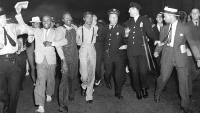 Two of 9 Scottsboro Boys freed, arrive Penn Station NYC, Olen Montgomery (glasses), Eugene Williams (suspenders) 072637 by AP