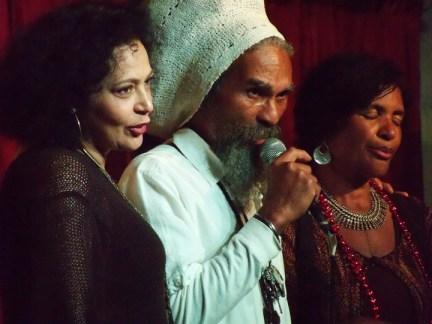 Val Serrant, center, leads healing chant for Jacque Barnes, rt, owner of Casa de Cultura, Berkeley 042713 by Wanda