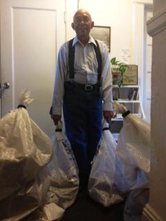 Willie Ratcliff w bulk mail sacks for Pelican Bay 050813 by Kenya