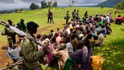 Congolese soldiers guard M23 who surrendered near Goma 110513 by Kenny Katombe, Reuters