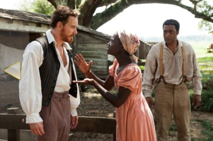 Michael Fassbender as Edwin Epps, Lupita NyongGÇÖo as Patsey, Chiwetel Ejiofor as Solomon Northup in GÇÿ12 Years a SlaveGÇÖ by