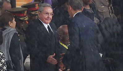 Raul Castro, Barack Obama shake hands at Mandela memorial 121013 Johannesburg