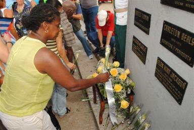 IFCO Co-Director Gail Walker at Rev. Lucius Walker plaque Havana's Anti-Imperialist Plaza 2012 Peace Caravan