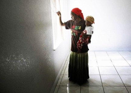 Marie Nadine Pierre squatting in foreclosed house Miami by J. Pat Carter, AP