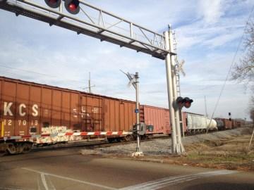Train at railroad crossing, Jackson, Miss