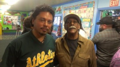 Tony Robles, co-editor of Poor Magazine, stands with Marcus Book Store co-owner Gregory Johnson at the press conference announcing the eviction of the oldest Black book store in the U.S. on May 12. – Photo: Poor News Network