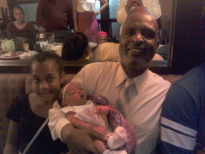At Gussie's Restaurant in the Fillmore, Rochelle happened upon the birthday celebrations of Dr. James McCray and his wife, Gail – 115 years combined, he said proudly – proud too of their grandchildren, Amina, left, Amira in his arms, and Keith. – Photo: Rochelle Metcalfe