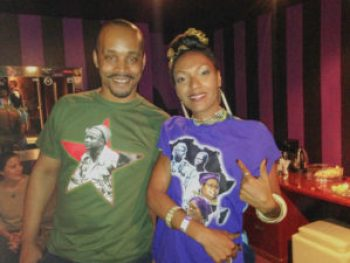 "Chris Zamani and Blue Nefertiti of Les Nubians model Chris' Hapo Zamani Za Kale Pan-African T-shirts. Chris wears the Amilcar Cabral shirt and Blue Nefertiti the design called ""Women."""