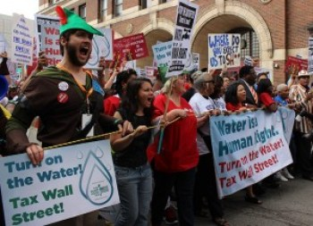 Hundreds march in the streets of Detroit on Friday, July 18, to protest the city shutting off water to 15,000 poor residents. – Photo: Rasheed Shabazz