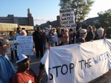 Detroit activists concerned about the massive water shutoffs across the economically devastated city blocked entrances into the yard of Homrich, a firm given a nearly $6 million contract to terminate services for hundreds of thousands of people. – Photo: Abayomi Azikiwe, Pan-African News Wire