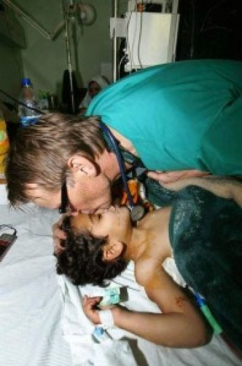 Dr. Mads Gilbert, a prominent Norwegian physician volunteering at Shifa Hospital, works with a young patient in Gaza.