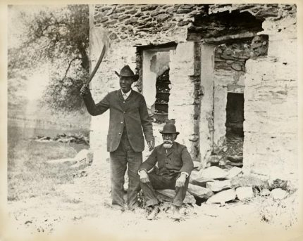 """Samuel Hopkins and Peter Woods, survivors of the Battle of Christiana, the topic of Michael Gene Sullivan's """"fugitive/slave/act,"""" returned 45 years later, in 1896, to pose for this photo in front of William Parker's brick house. – Photo courtesy of Moore's Memorial Library, Christiana"""