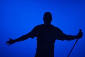 Donald Lacy in silhouette performing
