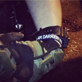 """The New York Times reports: """"The Justice Department on Friday pressured the Ferguson Police Department to stop its officers from wearing bracelets stamped with the message 'I am Darren Wilson,' in solidarity with the police officer who is being investigated for shooting an unarmed Black 18-year-old, and from covering up their name plates with tape."""" This photo has been tweeted around the world."""