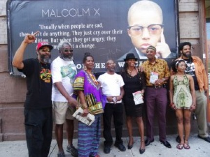 A team of leafleters spread the word of the UNIA Centennial in Harlem. – Photo: Wanda Sabir