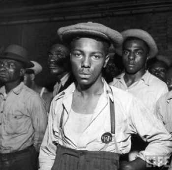 Black men were rounded up by Army troops when martial law was declared to quell race riots in Detroit, on June 20, 1943. – Photo: Gordon Coster, LIFE