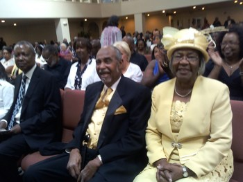 Dorothy Cook, with husband Alvin Cook and, at left, grandson Stevon Cook, candidate for SF Board of Education, celebrates her 80th birthday with a musical in her honor at Cornerstone Missionary Baptist Church. – Photo: Rochelle Metcalfe