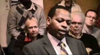 Lin Muyizere, husband of Rwandan political prisoner Victoire Ingabire, speaks to a Dutch journalist and audience after her 2010 arrest.