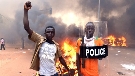 Protestors in Ougadougou lit the Parliament Building on fire to keep its members from amending Burkina Faso's Constitution to allow Blaise Campoare to cling to power.