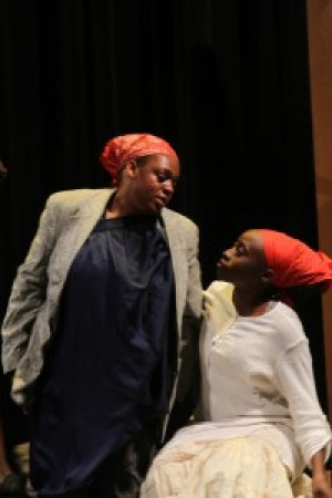 "Contrena Jones (left) as the wife of John Ross Jr. is comforted by plantation worker Kehinde Kujichagulia-Seitu in ""Go Tell It!"""