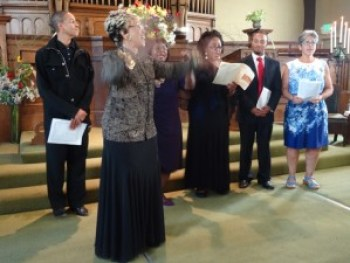 Howard Thurman Award winner Jacqueline Hairston, world acclaimed as a composer and arranger especially of spirituals, conducts the convocation section leaders in a medley of spirituals at Fellowship Church Oct. 19. – Photo: Wanda Sabir