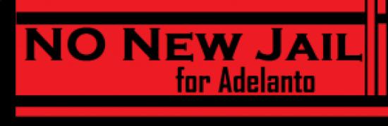 'No new jail for Adelanto' banner