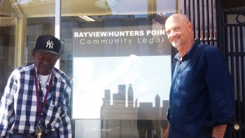 Volunteer housing attorney David Smith poses with a client in front of the Bayview Legal office at 4622 Third St.