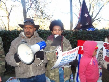 Benny Wenda leads the protest in London. Wenda is a West Papuan independence leader and international lobbyist living in exile in the U.K., where he was he was granted political asylum in 2003 by the British Government following his escape from custody while on trial in West Papua.