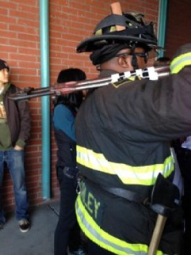 Finally, BART police called the Fire Department, who came with giant bolt cutters and chainsaws. Would they have gone through with their implied threat to cut the arms of the chained demonstrators? – Photo: Dave Id, Indybay