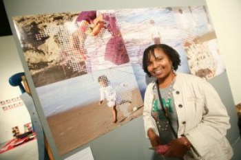 """""""In the exhibit we trace our movement from home to other places. Some people left the land of their birth fleeing death, while others were sold or kidnapped from home, never to return until generations later. The thread represents people's mapping their journeys. I had them start with their place of birth and then locate their ancestors,"""" Wanda says. – Photo: TaSin Sabir"""