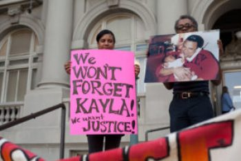 Kayla Moore's sister, Maria, and father, Arthur, protest at a rally before the Berkeley City Council meeting on April 30, 2013, where they were attacked by BPD. The pain of police murders – the sense of betrayal by those we pay to protect us – runs so deep that loved ones never forget. – Photo: Emilie Raguso, Berkeleyside