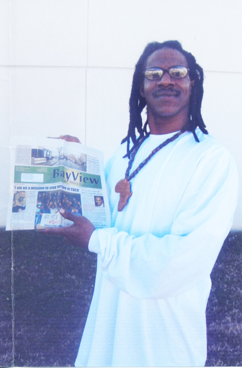 Anthony Robinson Jr. showing the SF Bay View Newspaper